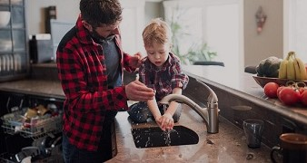 Father and son washing hands